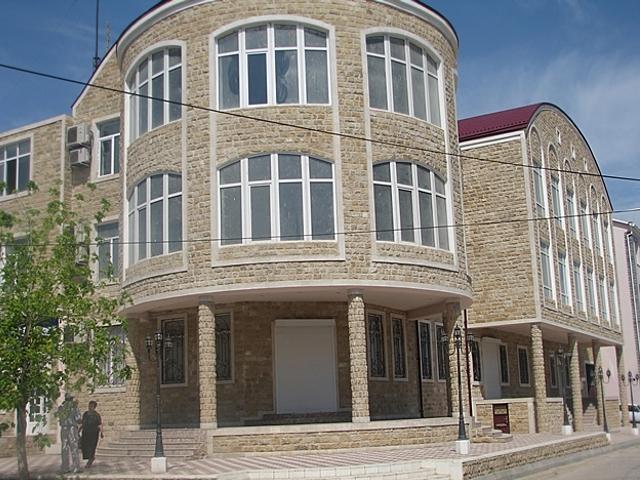 Фасад облицованный доломитом